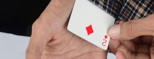 Dealer Accused of Hiding a Playing Card up His Sleeve